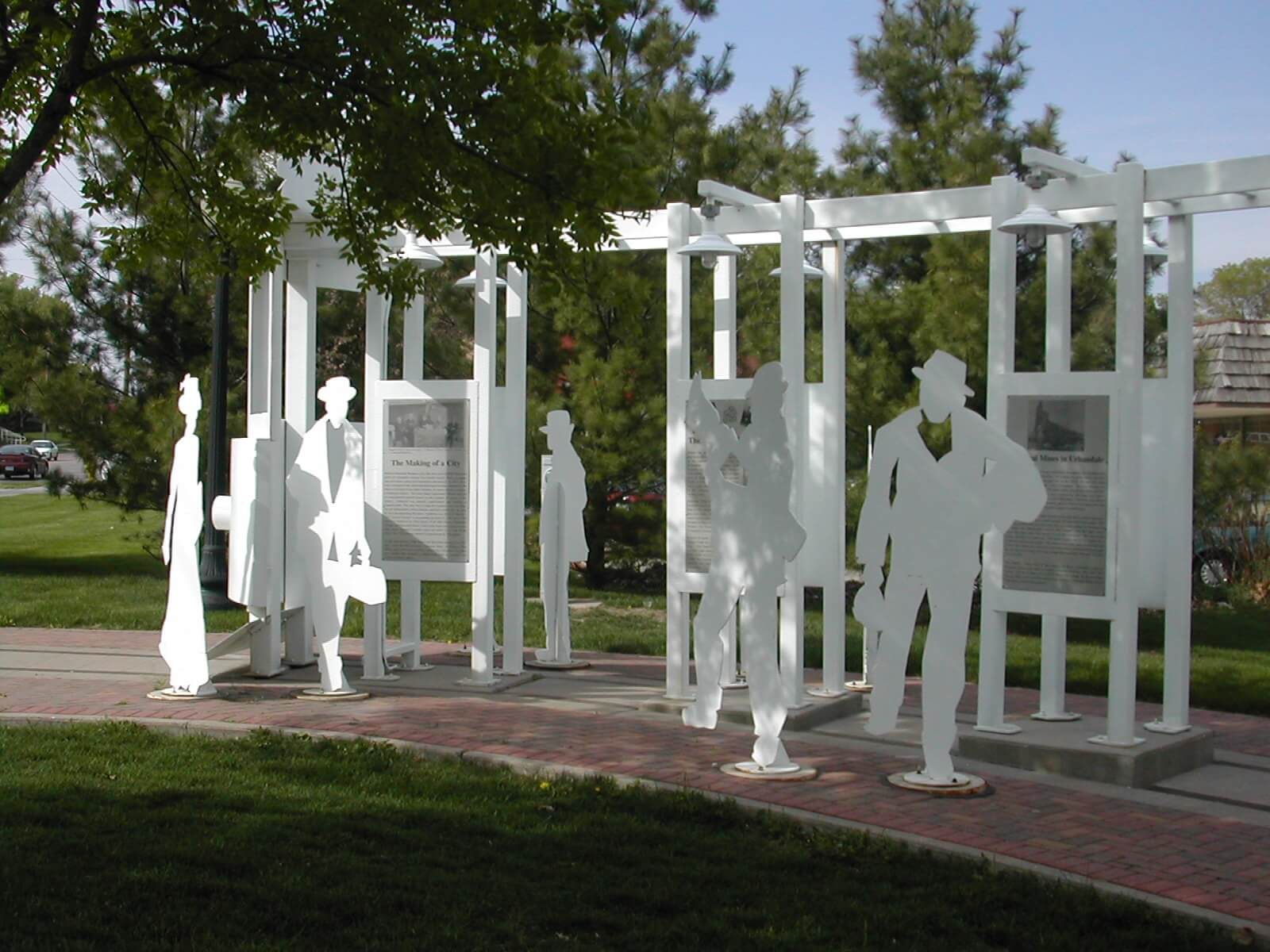 A sculpture/art installment of many silhouetted people.