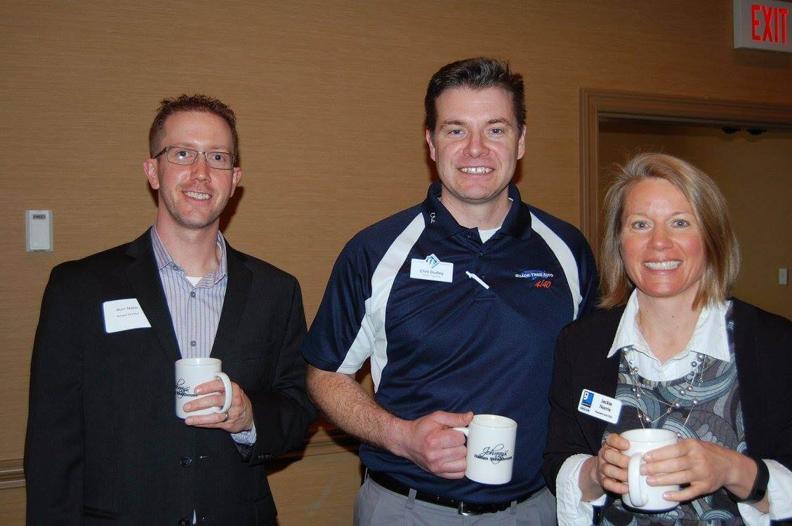 Chamber members meet and greet at a networking event.