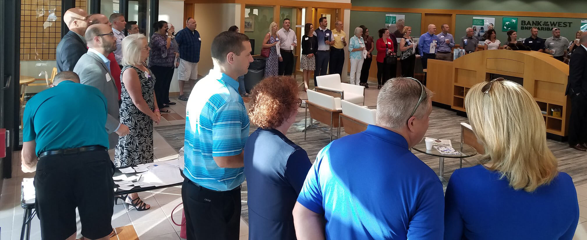 Members of the chamber circle up at a local bank.
