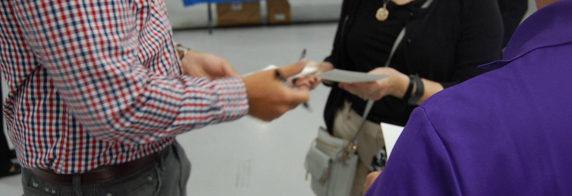 Members exchange contact information.