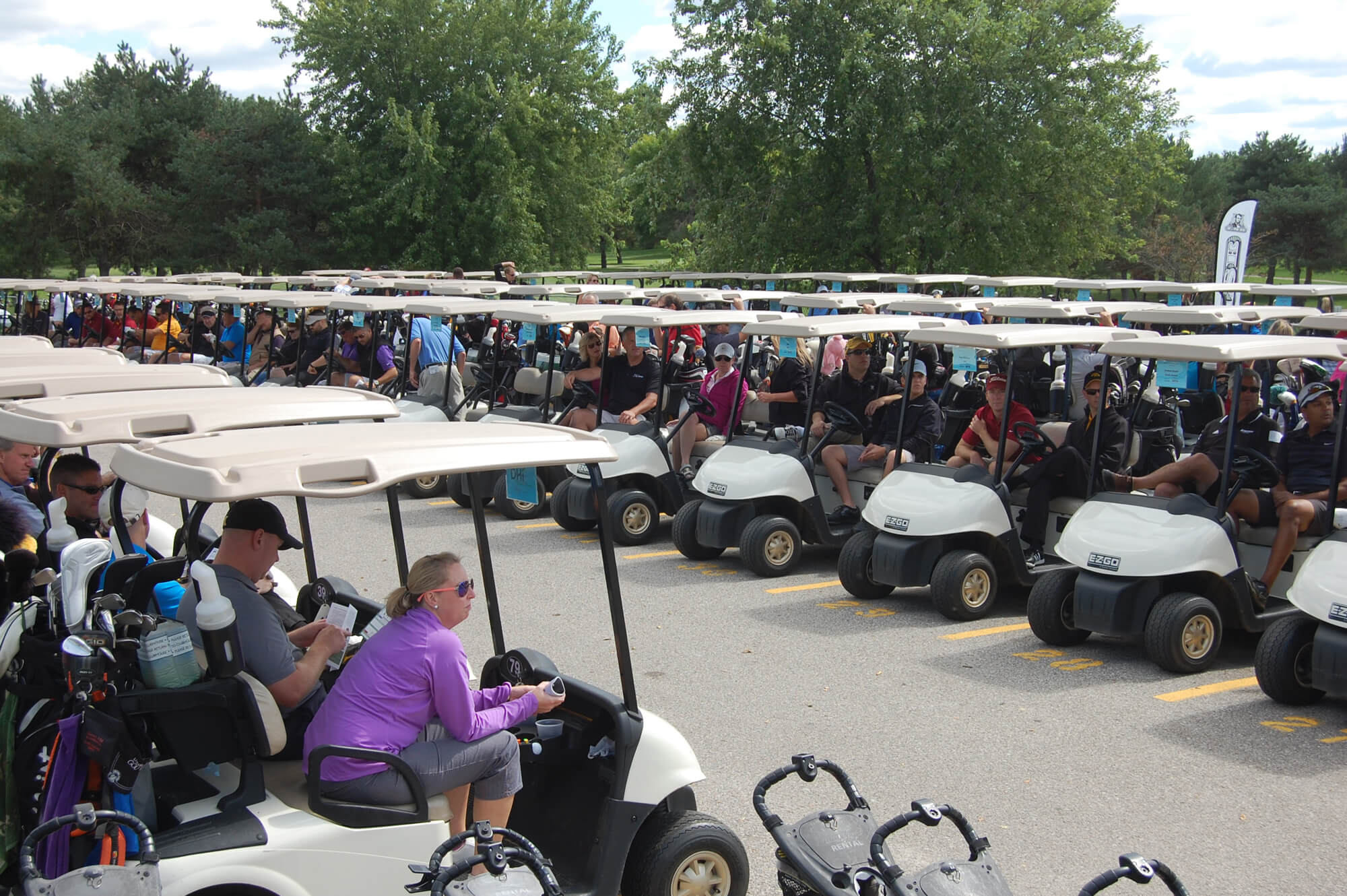 Golf carts are lined up in preparation for an event.