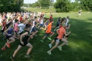 Children running in a field.