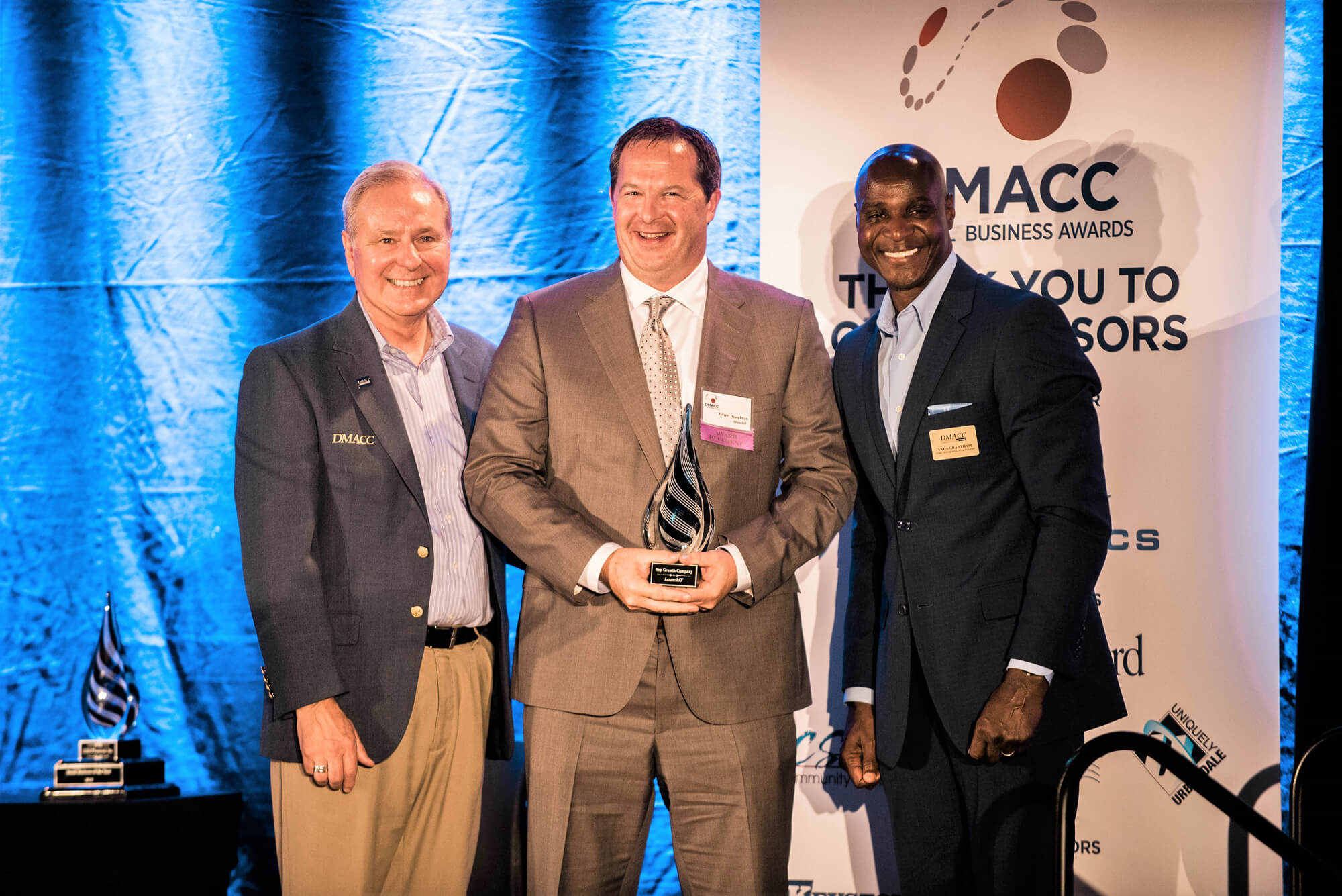 Three men smile at the 2018 DMACC small business awards.