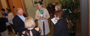 A circle of chamber members exchange information at a contacts and contracts meeting.