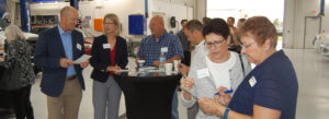 Members interact at a networking event.