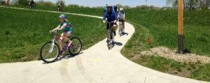 Families on bikes utilize bike trails.
