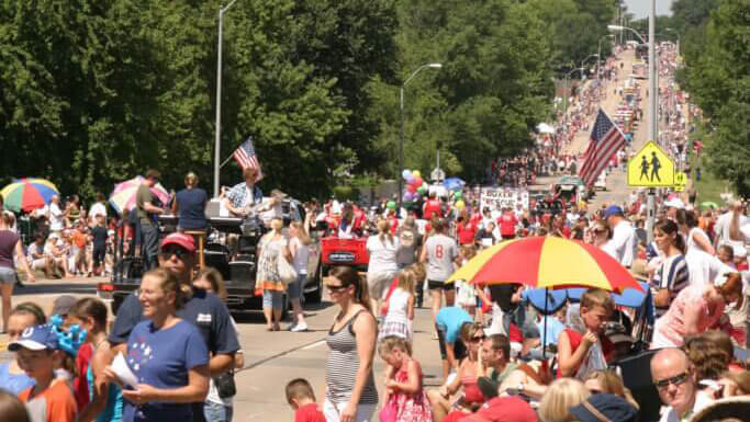 Crowds gather and watch the 2011 Urbandale fourth of July parade.