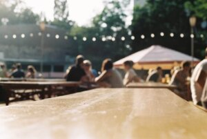 Picnic table with people sitting around